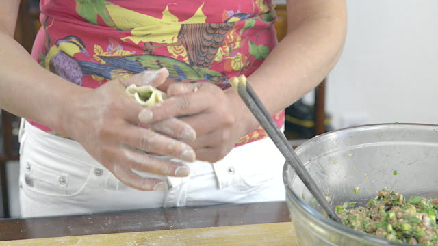 Woman Stuffing Chinese Dumplings