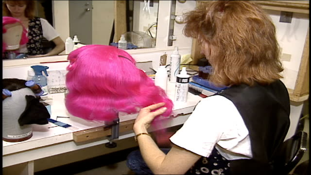 woman styling and brushing a pink wig - stage costume stock videos & royalty-free footage