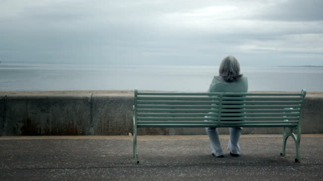 woman suffering by the sea - senior women stock videos & royalty-free footage