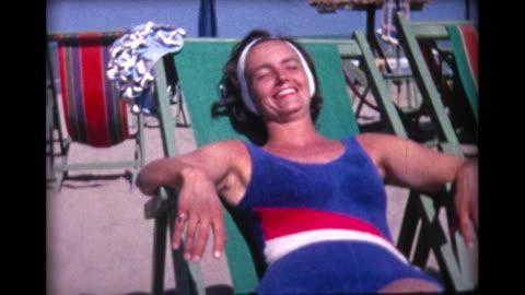 1964 woman sunbathing on lido beach - archival stock videos & royalty-free footage