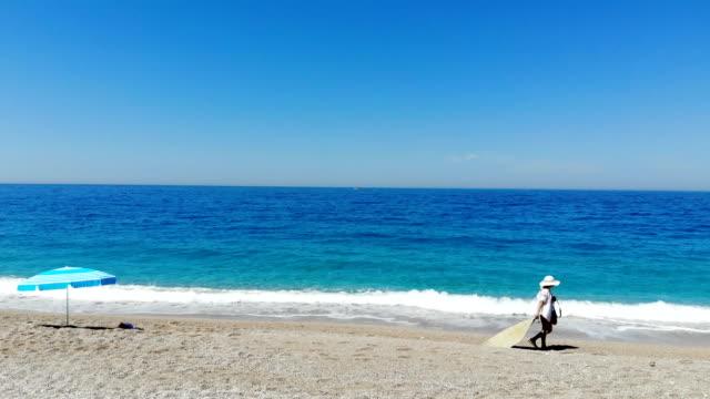 woman sunbathing on the beach. - ölüdeniz stock videos and b-roll footage