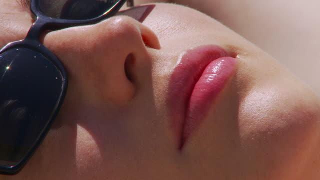 woman sunbathing - sunbathing stock videos & royalty-free footage