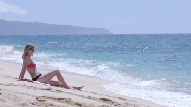 Woman Suntanning on Beach