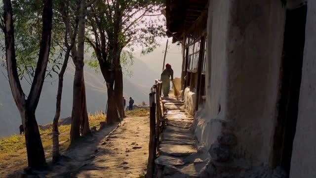 woman sweeps step, yagnob valley, tajikstan - sweeping stock videos & royalty-free footage