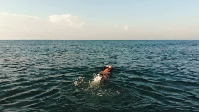 woman swiming sea slow motion - swimming stock videos & royalty-free footage