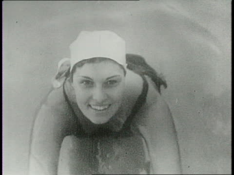 woman swimmer backflips off high-dive / beverly beck, helen grelenkovich diving / judges hold up score cards / large crowd in stand watches diver... - backstroke stock videos & royalty-free footage