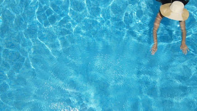 woman swimming at an empty pool at the beach in almeria - mar stock videos & royalty-free footage