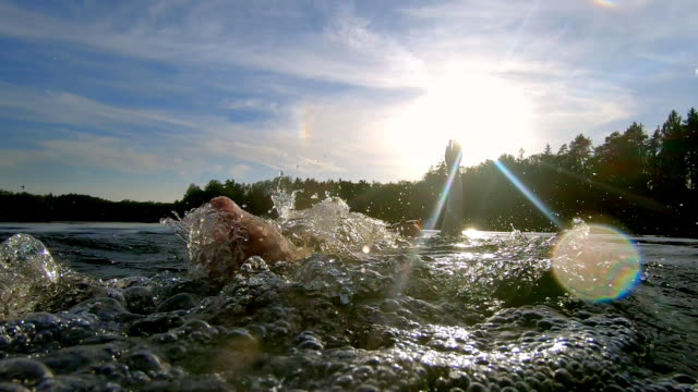 woman swimming backstroke in lake - lakeshore stock videos & royalty-free footage
