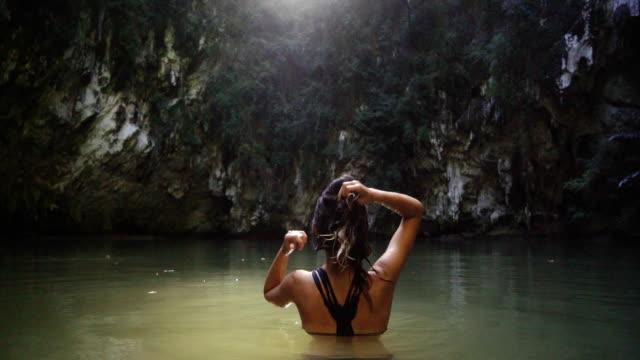 woman  swimming in lagoon - floating on water stock videos & royalty-free footage