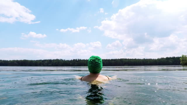 woman swimming in lake with swimming cap - swimming cap stock videos & royalty-free footage