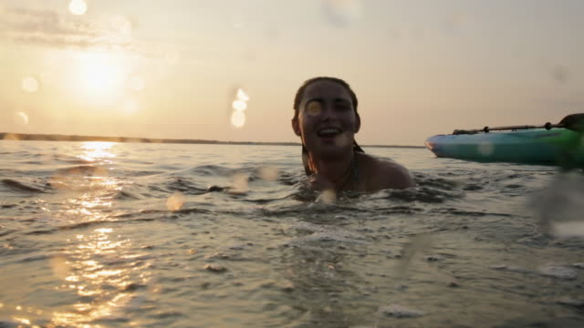 woman swimming in ocean splashing water at camera - the florida keys stock videos & royalty-free footage