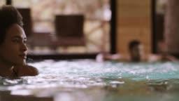 Woman swimming in spa pool