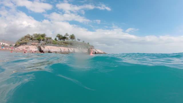 Woman swimming in Tenerife