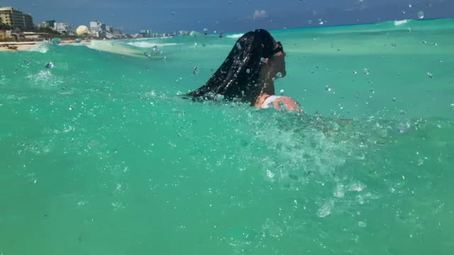 woman swimming in the ocean in slow motion - cancun stock videos & royalty-free footage