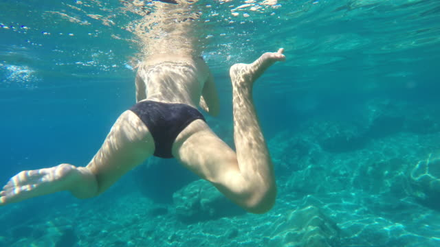 ws woman swimming in the sea - swimwear stock videos & royalty-free footage