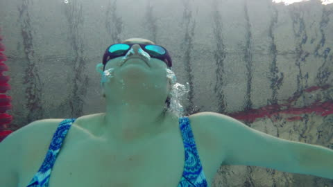 woman swimming on indoors pool - swimming goggles stock videos & royalty-free footage