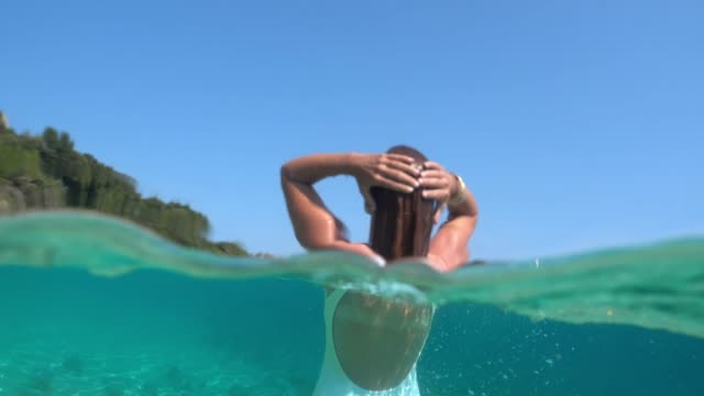 ms woman swimming underwater in sunny blue ocean - swimwear stock videos & royalty-free footage