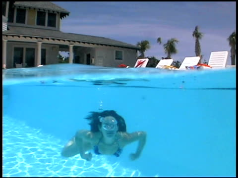 woman swimming underwater - surfacing stock videos and b-roll footage