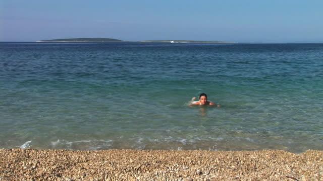 hd: woman swimming - adriatic sea stock videos & royalty-free footage