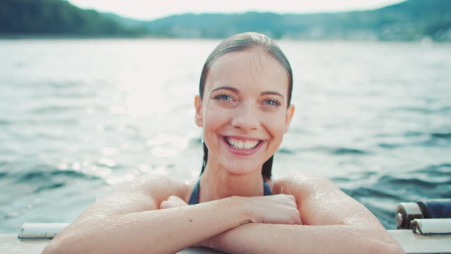 woman swimming - lake stock videos & royalty-free footage