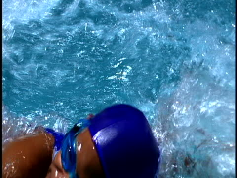 woman swimming - swimming cap stock videos and b-roll footage