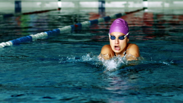 woman swims breaststroke style - contest stock videos & royalty-free footage