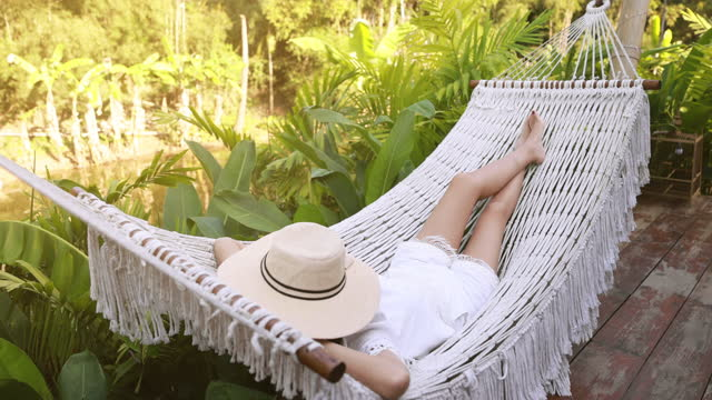 woman swing and relax in hammock - tourist resort stock videos & royalty-free footage
