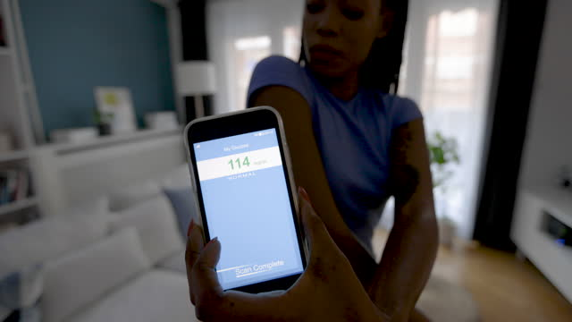 woman swiping sensor with smart phone for glucose measurement - metabolic syndrome stock videos & royalty-free footage