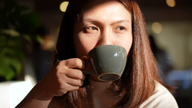 woman take a coffee at cafe in relax time - mug stock videos & royalty-free footage