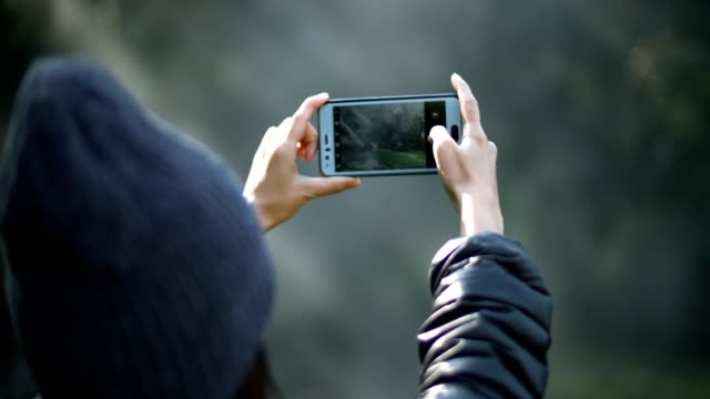 woman take a photo in beautiful nature - photographing stock videos & royalty-free footage