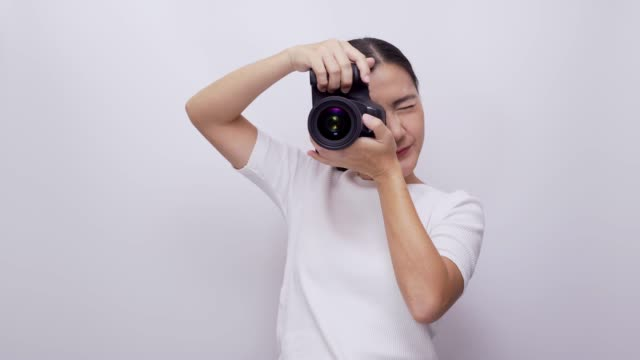 woman take a photo on white background 4k - photographer stock videos & royalty-free footage