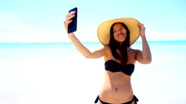 woman take a selfie at the sea