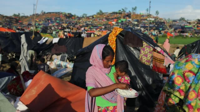 a woman take food to her son at hakimpara in cox's bazar according to unhcr more than 7000 rohingya refugees have fled from myanmar rakhine state... - cox basar stock-videos und b-roll-filmmaterial