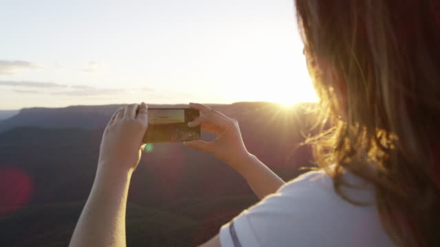 ms a woman takes a photograph at echo point / katoomba, australia - photography themes stock videos & royalty-free footage