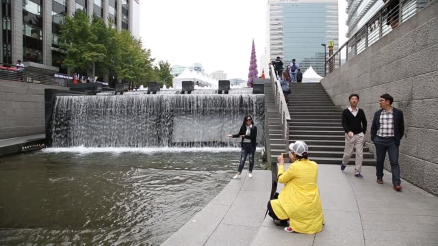 A woman takes a selfie at the Cheonggyecheon stream in Seoul South Korea on Wednesday Oct 26 A woman poses for a photograph at the Cheonggyecheon...