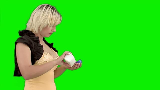 Woman takes a tablet.