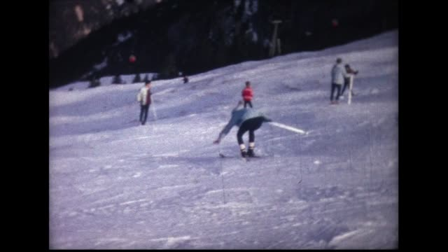 1963 woman takes fall on skis - skifahren stock-videos und b-roll-filmmaterial