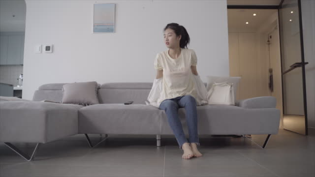 woman takes off her underwear as soon as she comes home, seoul, south korea - bra stock videos & royalty-free footage