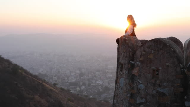 woman takes smart phone pic above city, from fortress walls - finden stock-videos und b-roll-filmmaterial