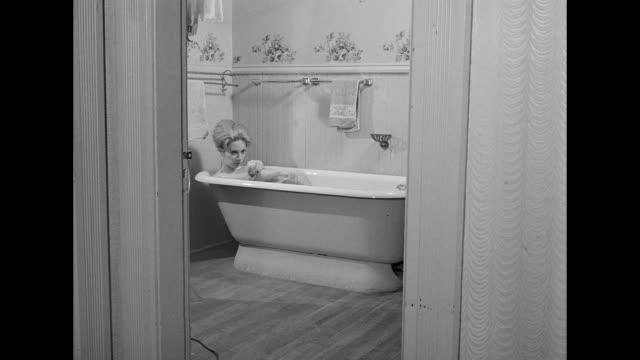1962 woman taking a bath - bath stock videos & royalty-free footage