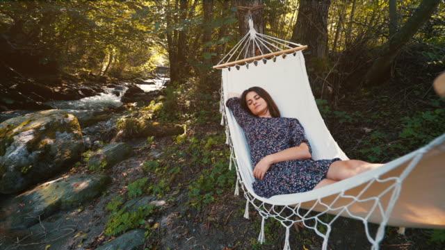 woman taking a nap in hammock. - millennial generation stock videos & royalty-free footage