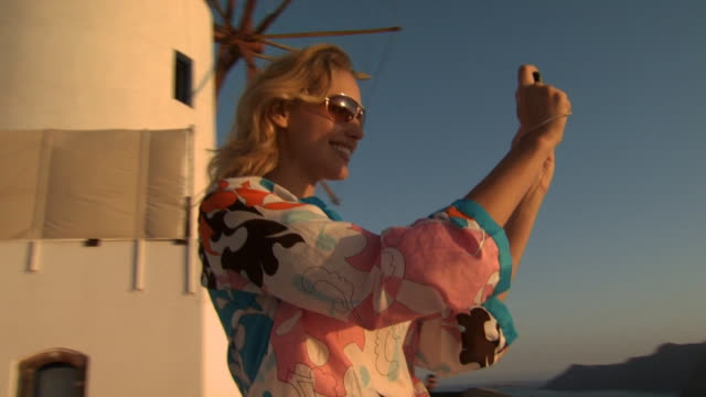 A woman taking a picture in Mykonos