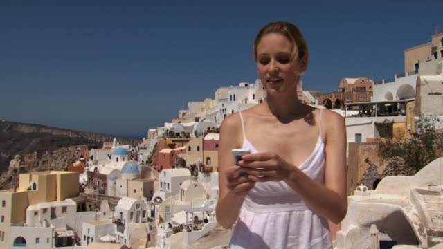 A woman taking a picture in Santorini