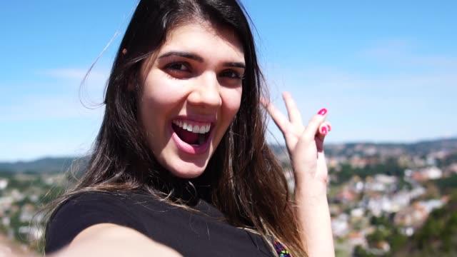 woman taking a selfie in campos do jordao, sao paulo, brazil - femininity photos stock videos & royalty-free footage