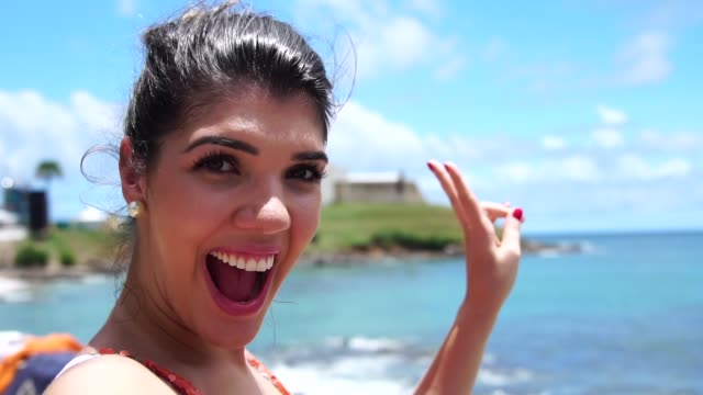 woman taking a selfie in farol da barra, salvador, brazil - bahia state stock videos & royalty-free footage