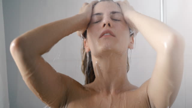 woman taking a shower. - naked stock videos & royalty-free footage