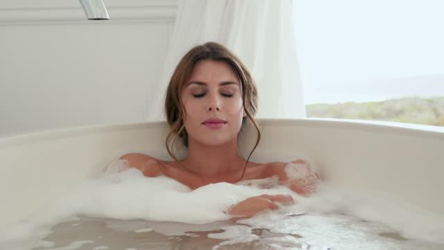 woman taking bath - bath stock videos and b-roll footage