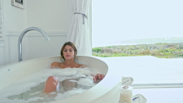 woman taking bath - taking a bath stock videos and b-roll footage