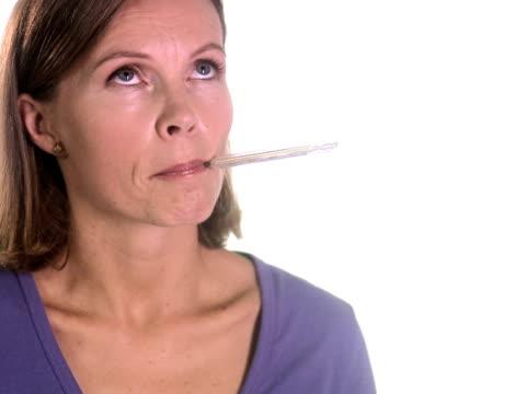 vídeos y material grabado en eventos de stock de a woman taking her temperature. - una sola mujer madura