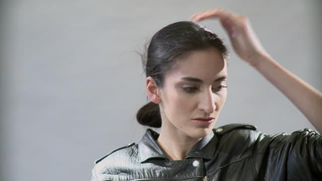 ms woman taking off motorcycle helmet in studio - sturzhelm stock-videos und b-roll-filmmaterial
